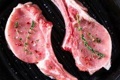 Raw steaks in grill pan ready to cook Royalty Free Stock Photography