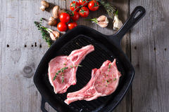 Raw steaks in grill pan ready to cook Royalty Free Stock Photos