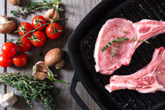 Raw steaks in grill pan ready to cook Stock Image