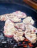 Raw steaks on a grill Royalty Free Stock Image