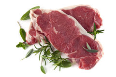 Raw Steaks with Herbs stock image