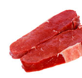Raw Steaks with Herbs ,isolated on White Royalty Free Stock Photography