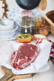Raw steaks on the kitchen table. Ready to cook Stock Photos
