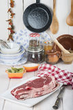 Raw steaks on the kitchen table Stock Image