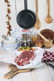 Raw steaks on the kitchen table. Ready to cook Royalty Free Stock Image