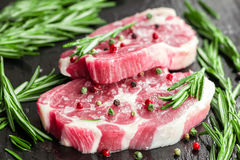 Raw steaks Stock Photos