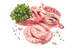Raw Steaks And Sausages royalty free stock photo