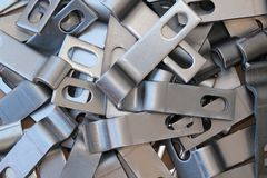 Raw steel parts. CNC punched raw steel parts bent and hole punched Stock Images