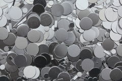 Raw steel scrap. CNC punched raw steel parts circles Stock Image