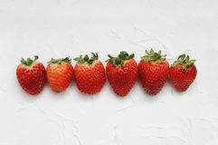 Raw of Strawberries Isolated on White Background. Fresh Summer Berries. royalty free stock image