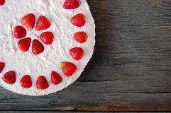 Raw strawberry cake on rustic wooden table Stock Photography