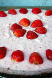 Raw strawberry cake on rustic wooden table Royalty Free Stock Photos