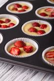 Raw strawberry muffins in baking dish macro Royalty Free Stock Photo