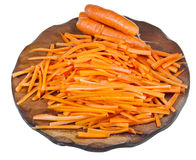 Raw strips sliced carrot on cutting board Stock Image