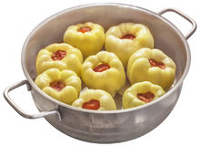 Raw Stuffed Bell Peppers, In Stainless Steel Sauce Pot, Isolated On White Background Royalty Free Stock Images