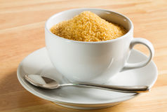 Raw sugar in the coffee cup Royalty Free Stock Image