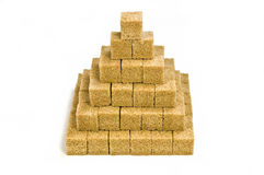 Raw sugar cubes. Golden brown raw sugar cubes isolated on white background Stock Photography
