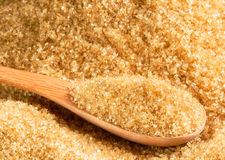 Raw sugar in wood spoon Stock Photography