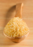 Raw sugar in the wood spoon Stock Photo