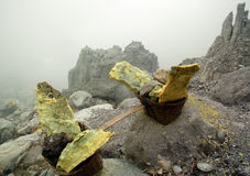 Raw sulfur. Load of raw sulfur in the Ijen volcano in Indonesia royalty free stock photo