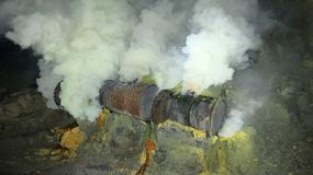 Raw sulfur mining in the crater of Kawah Ijen active volcano on Java royalty free stock image