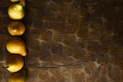 Autumn background, pear pattern on old wooden rustic table stock photography