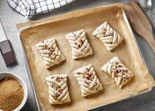 Raw sweet buns on baking pan Royalty Free Stock Images