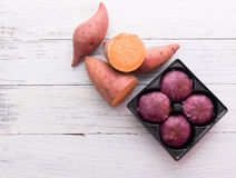 Raw sweet potatoes with potato pie Royalty Free Stock Images