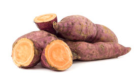 Raw sweet potatoes on white Stock Image