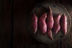 Raw sweet potatoes Royalty Free Stock Photos