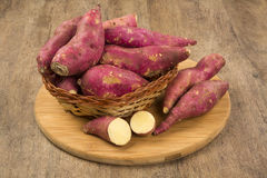 Raw sweet potatoes on wooden background closeup Royalty Free Stock Image