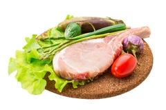 Raw t-bone steak Stock Images