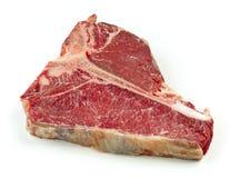 Raw T bone steak. Isolated on white background stock image