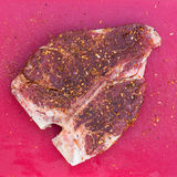 Raw T-Bone Steak with Seasoning Stock Image