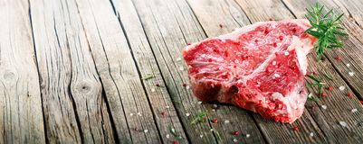 Raw T-Bone Steak On Wooden With Rosemary Royalty Free Stock Photography