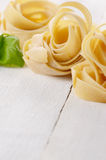 Raw pasta tagliatelle Stock Photos