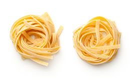 Raw Tagliatelle Pasta Nests Isolated On White Background. Top view royalty free stock photos