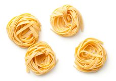 Raw Tagliatelle Pasta Nests Isolated On White Background. Top view stock photography