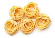 Raw Tagliatelle Pasta Nests Isolated On White Background. Top view royalty free stock photo