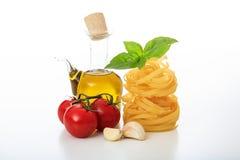 Raw tagliatelle on a white background. Raw tagliatelle pasta on a white background Stock Photography