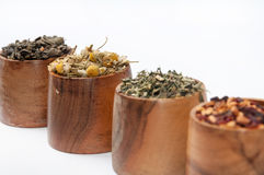 Raw tea in wooden cups Royalty Free Stock Photos