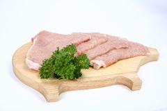 Raw tenderized pork chops Royalty Free Stock Images