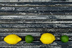 Raw textured black  Background backdrop with lemon and lime Royalty Free Stock Image