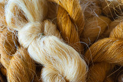 Raw Thai silk. Thread background royalty free stock image