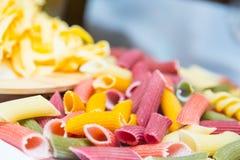 Raw three colored Italian pasta Stock Photos