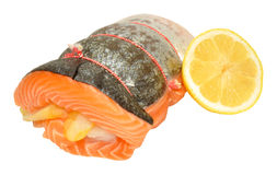 Raw Three Fish Roast. With salmon rolled around smoked haddock and cod isolated on a white background Stock Images