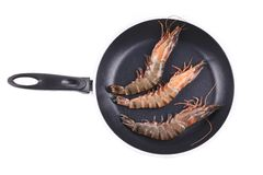 Raw tiger shrimps on frying pan. Stock Images