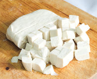 Raw tofu. Cut in dices on wooden board Stock Images