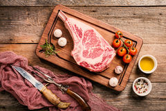 Raw tomahawk beef steak Royalty Free Stock Images