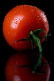Raw tomato on black background Stock Photo